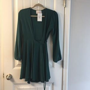 Brand new. Dark green deep V wrap dress